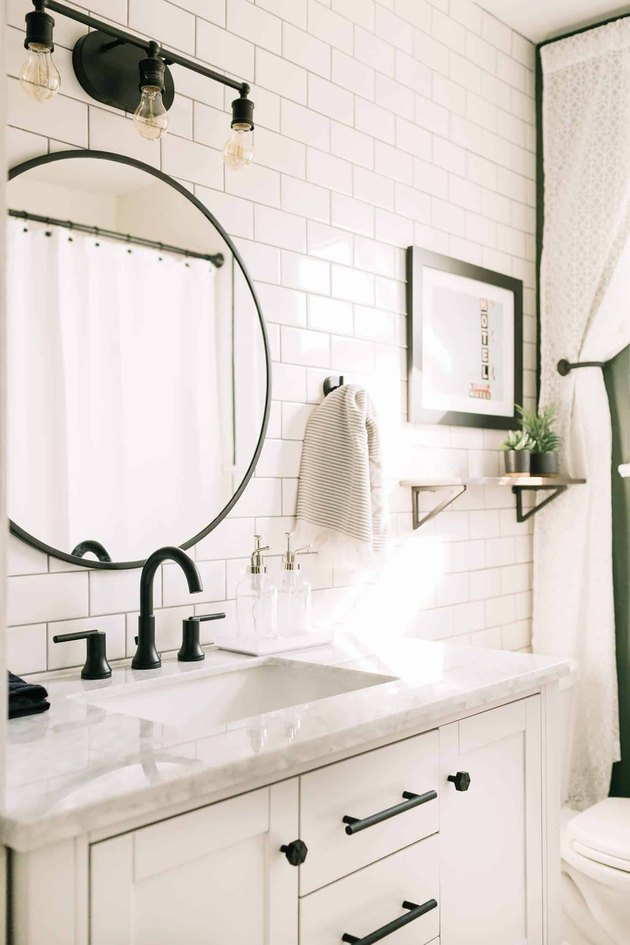white subway ceramic tile on bathroom wall