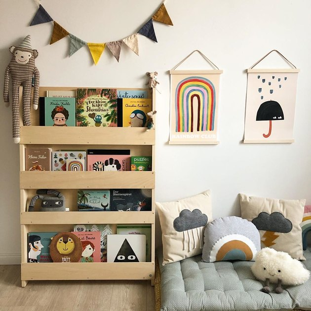 Scandinavian kids bedroom idea with floor cushion reading area