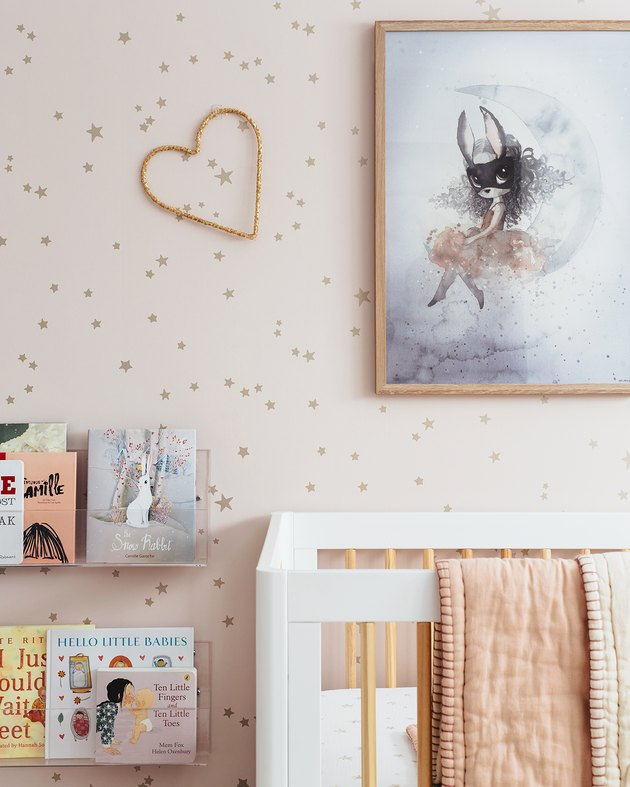 pink nursery idea with blush pink star wallpaper and white crib