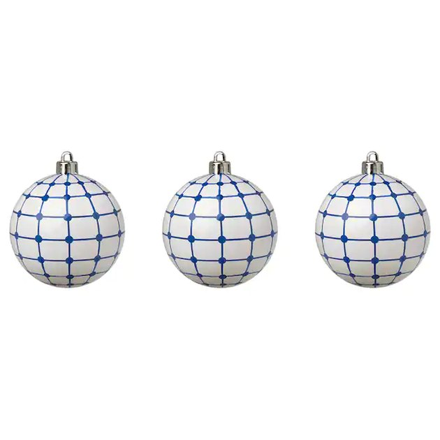 three white and blue patterned ornaments