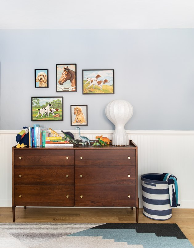 Midcentury kids' bedroom idea with featuring vintage furniture, a modern lamp, and blue and white walls