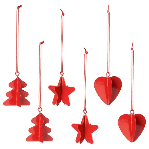 hanging red ornaments in the shape of tree, star, and heart