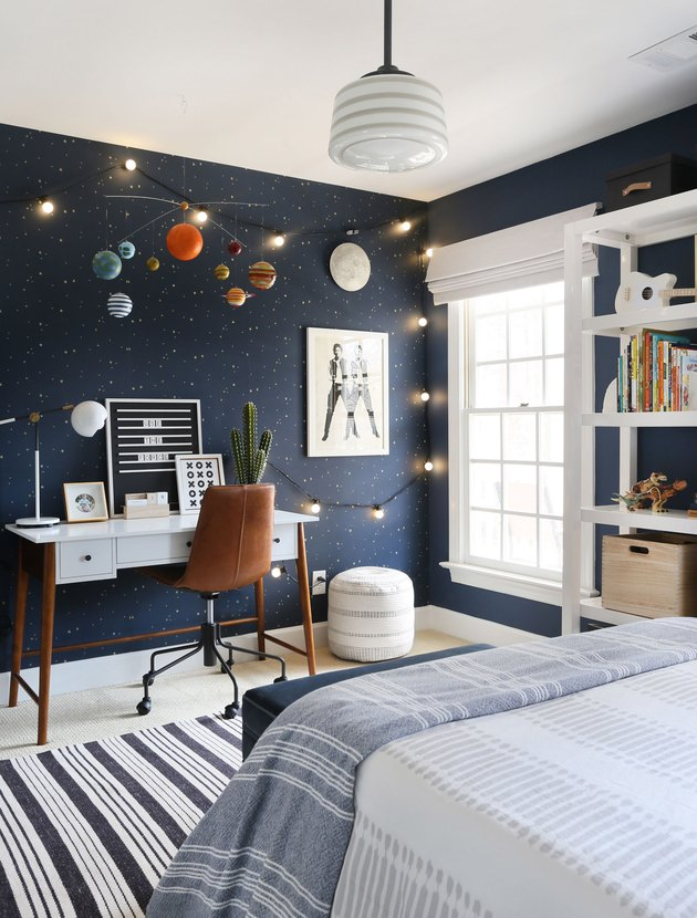 midcentury kids bedroom idea with desk and leather task chair and blue walls