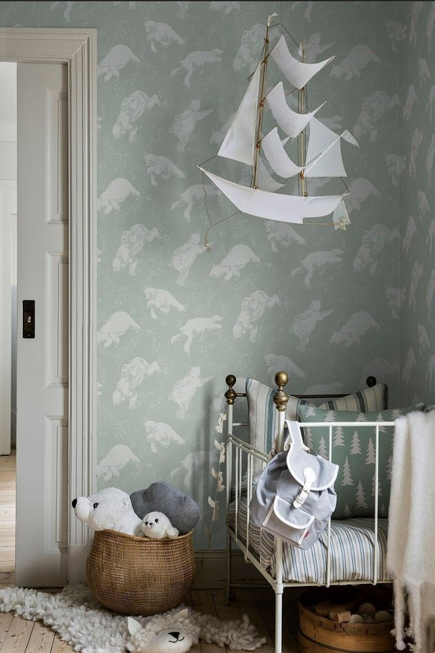 light green kids bedroom idea with polar bear printed wallpaper in Scandinavian kids room