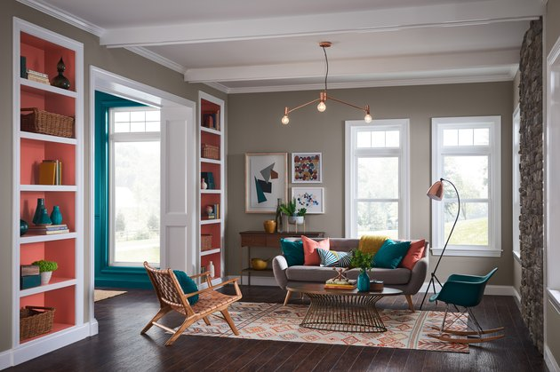 living room with gray wall and bright orange bookshelves