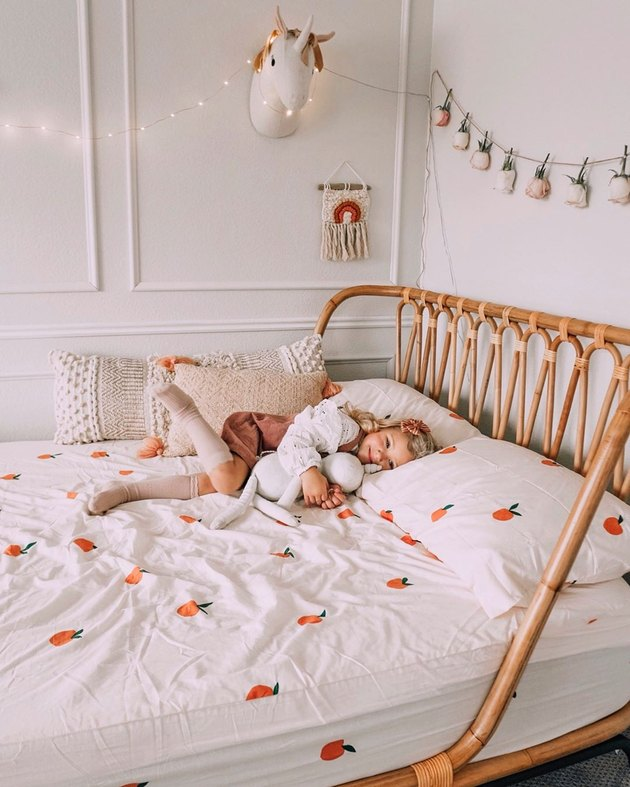all-white Scandinavian kids bedroom idea with rattan bed