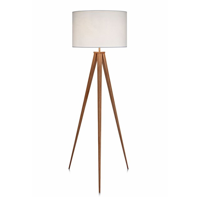 Tripod floor lamp with wooden legs in medium finish and white shade