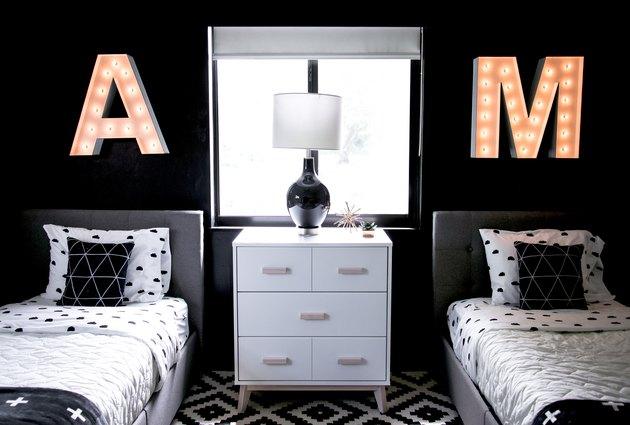 black gender neutral shared kids bedroom idea with neon lights