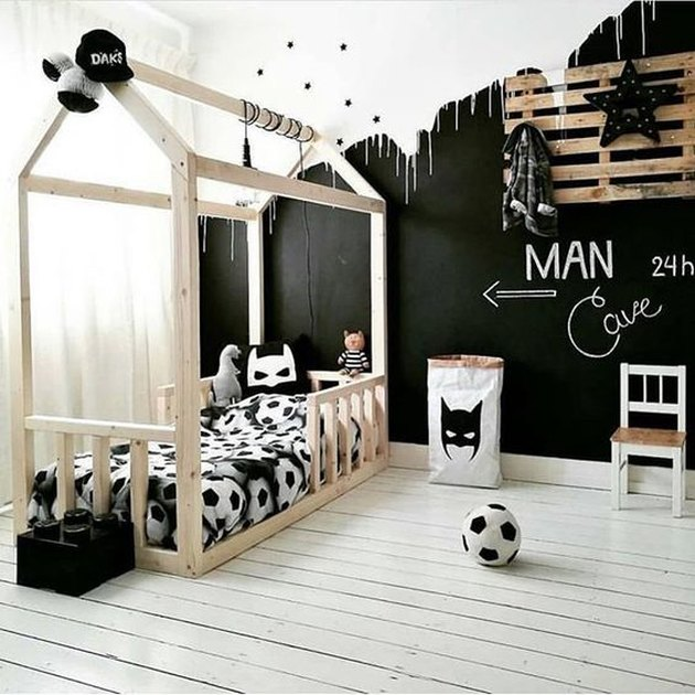kids' bedroom idea with black chalkboard paint and house-shaped bed frame