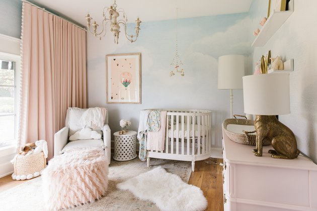 pink and blue baby nursery idea with floor to ceiling drapery and white crib