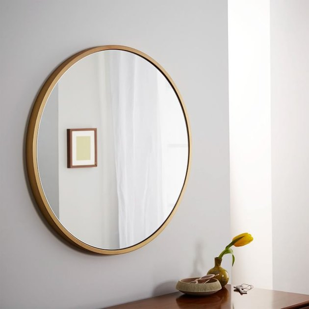Round wall mirror with brushed brass border