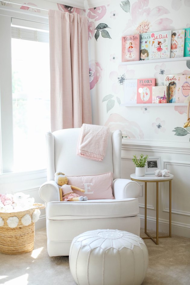 pink and white nursery idea with floral print wallpaper and pink drapery with white rocker