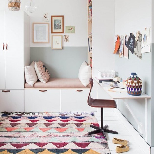 Scandinavian kids bedroom idea with  leather pulls on white built-in cabinets