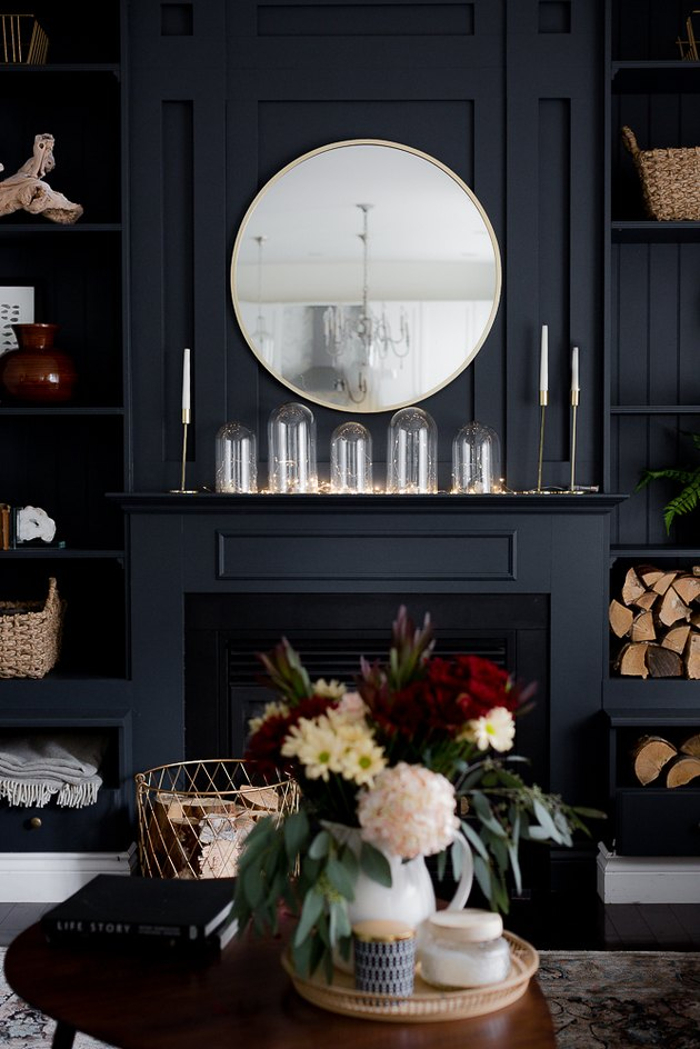 Display of glass cloche on mantel