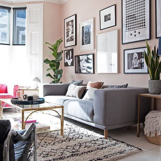 pink living room with black and white gallery wall