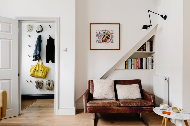 hallway closet idea with wall hooks for jackets, bags, hats, and shoes