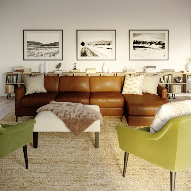 living room space with brown leather couch and green chairs