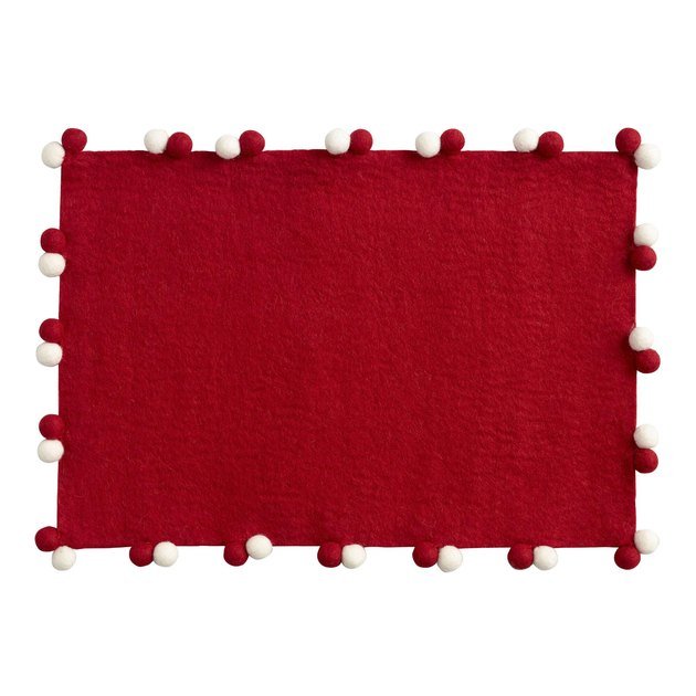 red place mats with red and white pom poms
