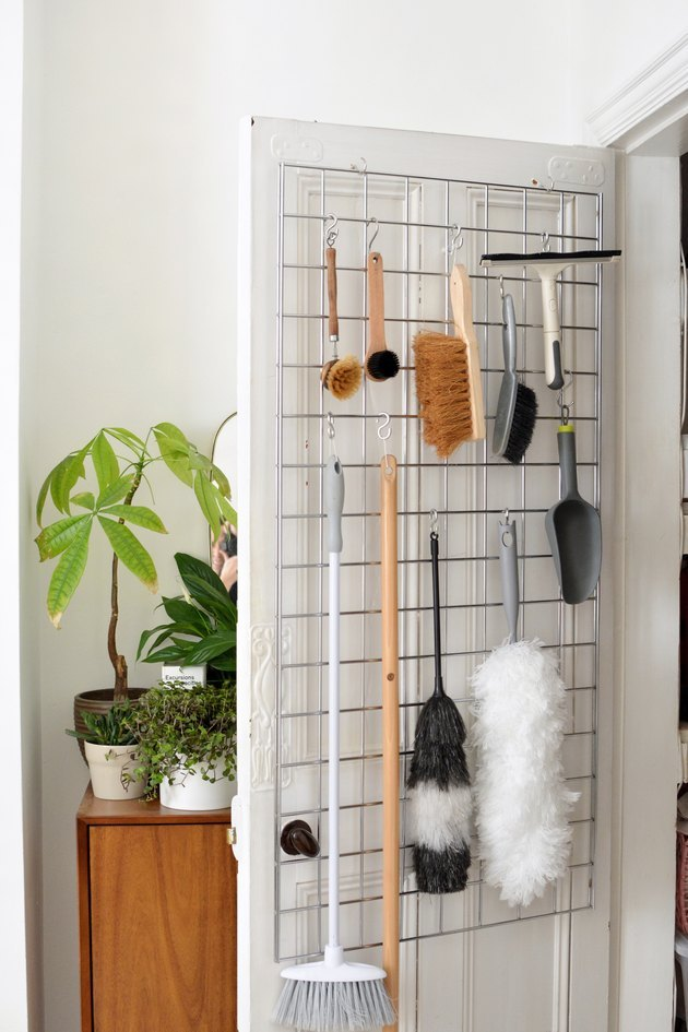 cleaning closet idea with over-the-door storage for essentials