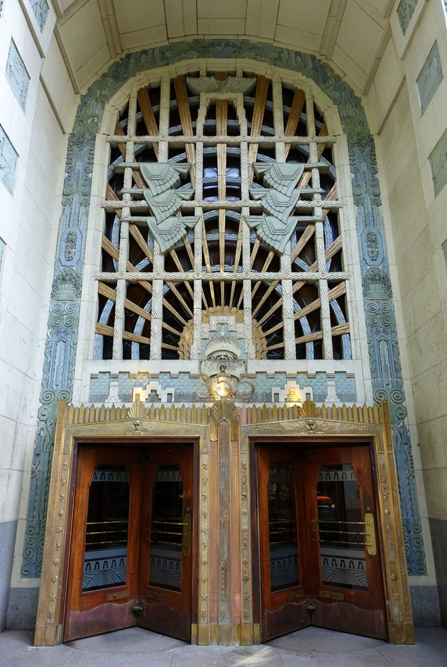 exterior shot of the doors with intricate art deco details in the Marine Building in Canada