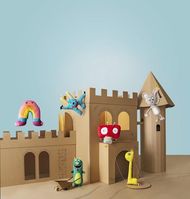IKEA toys in cardboard castle
