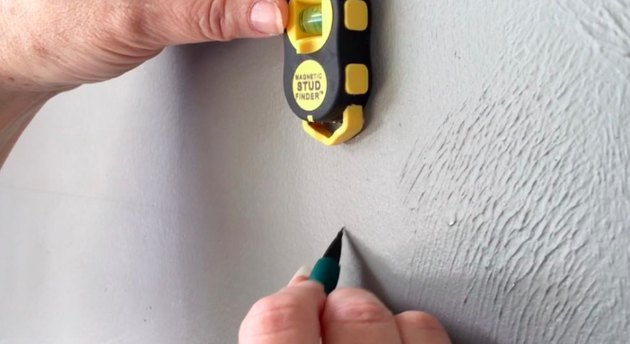 Stud finder in use.