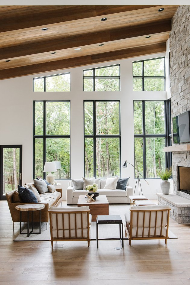 living room with a sloped ceiling and a wall of windows