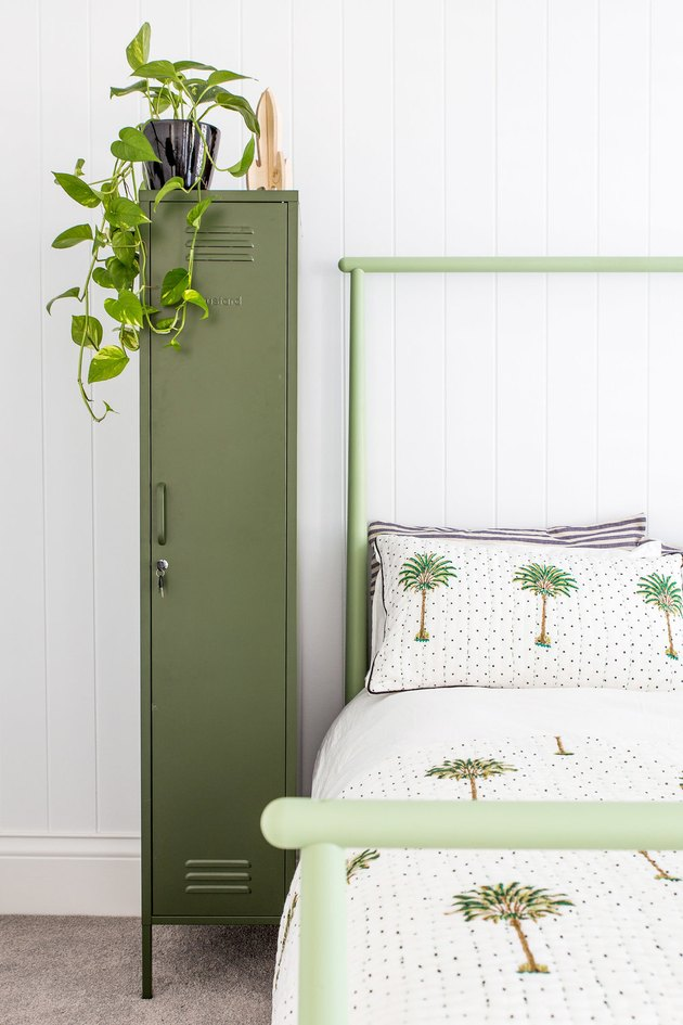 teen bedroom idea for girls with green locker and green bed frame to match tropical bedding