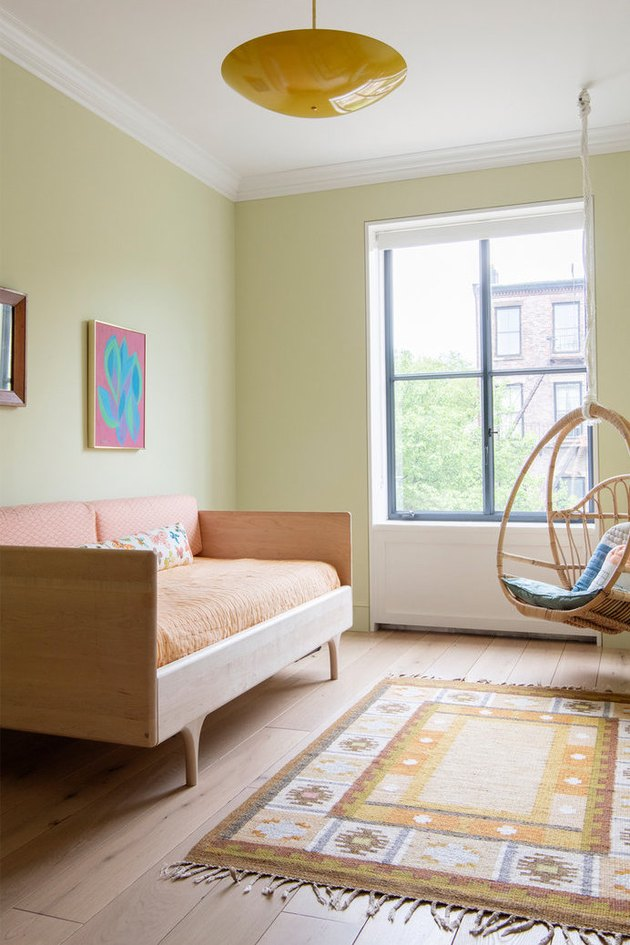 teen bedroom idea for girls with green walls and peach accents
