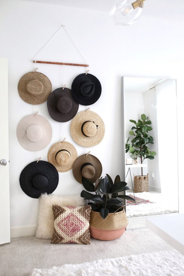 hats hung on wall with clothespins