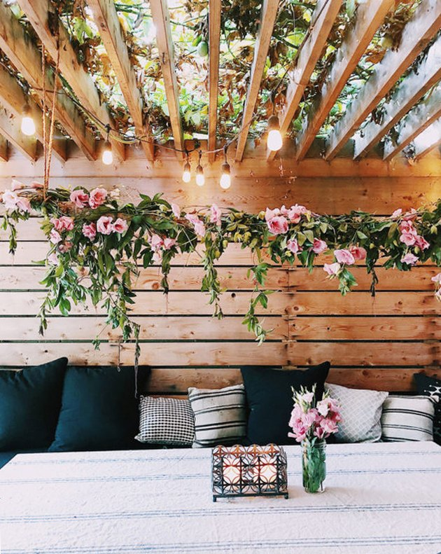 outdoor dining space with hanging florals