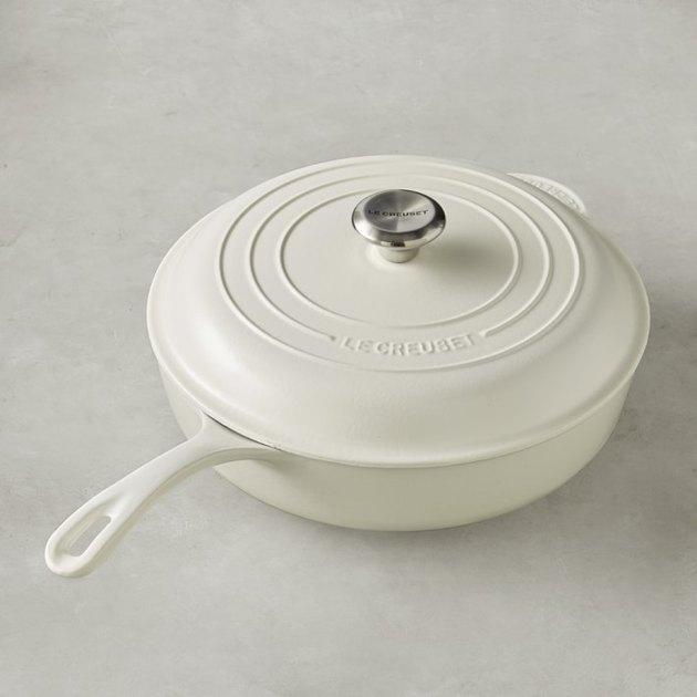 white Le Creuset cast-iron pan