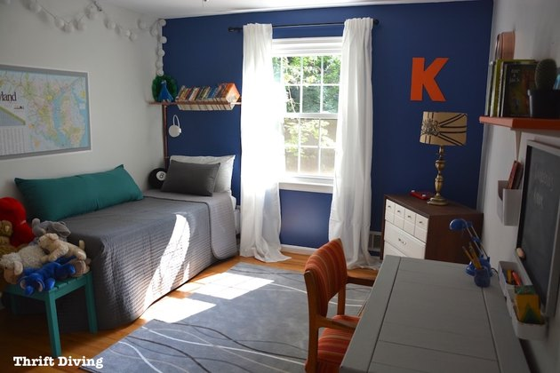 blue accent wall in bedroom