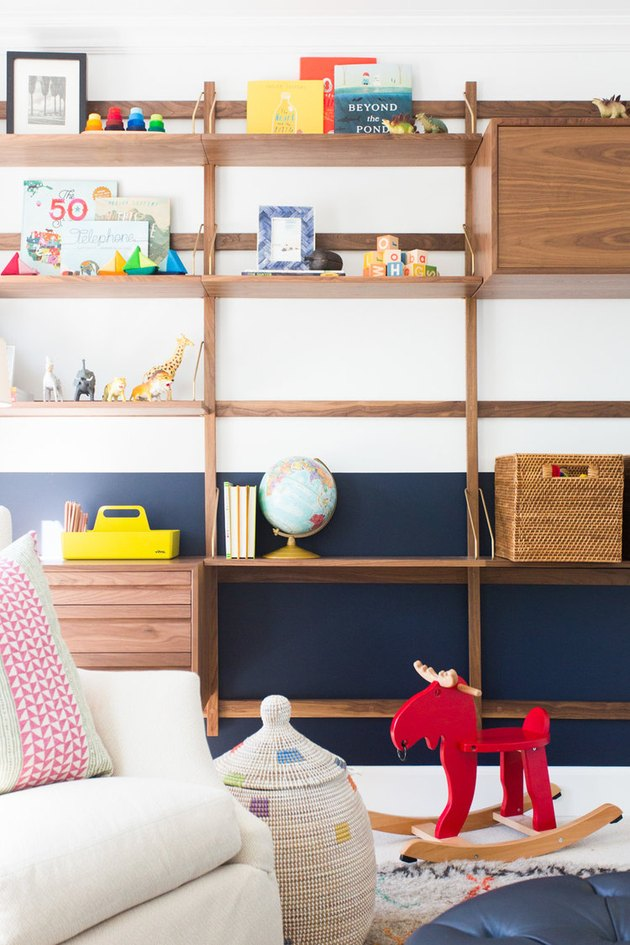midcentury playroom storage idea with wall-mounted storage unit