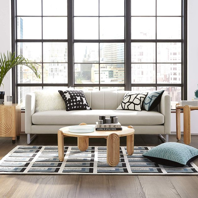 living room with white sofa, wood coffee table