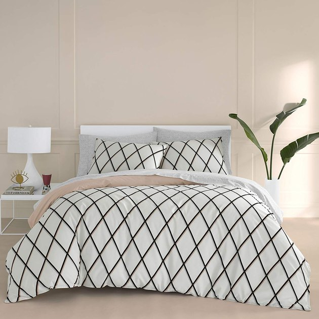 bed with white cross-crossed duvet