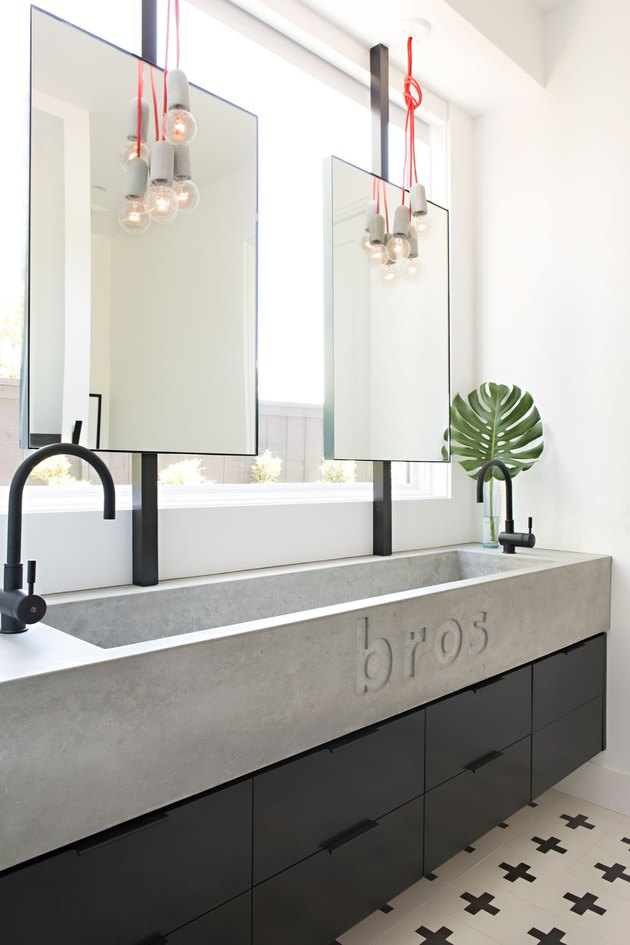 "kids bathroom idea with engraved ""bros"" trough sink, black cabinets"