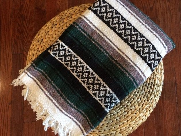 Mexican blanket featuring white, gray, black, and dark green