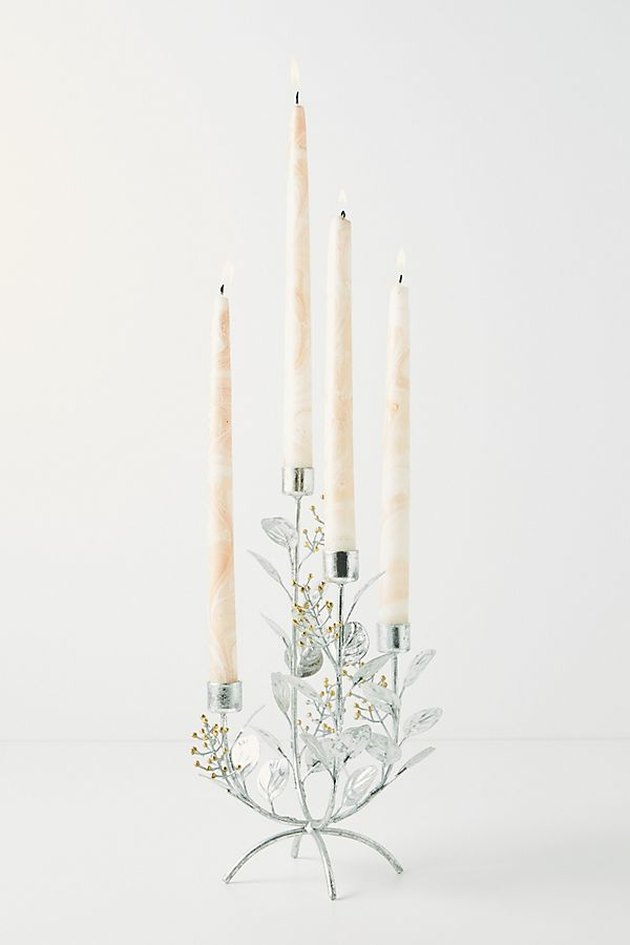 four candles in silver candleholder with foliage details