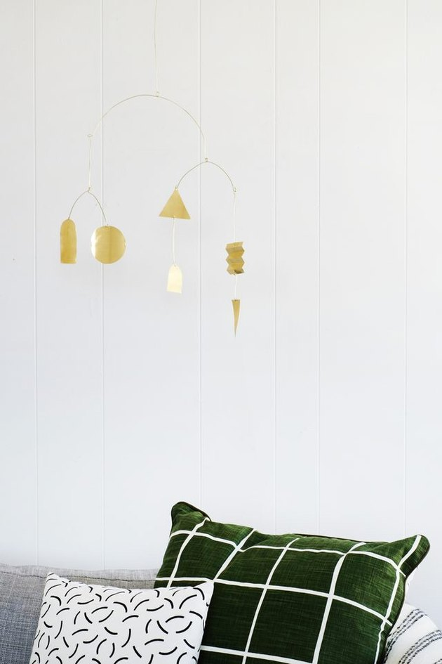DIY modern brass mobile above sofa