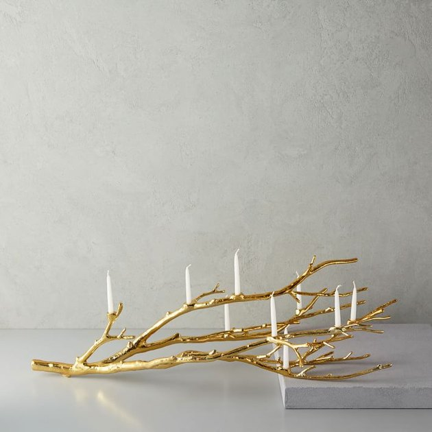 candleholder in the shape of gold branches