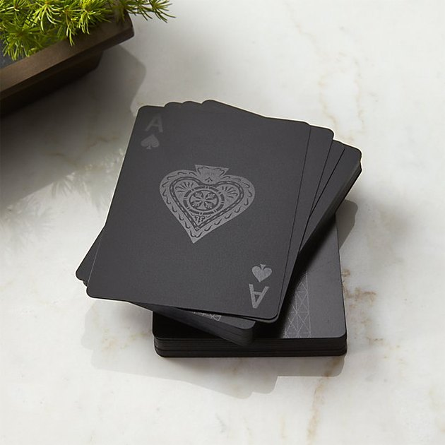 stack of black playing cards