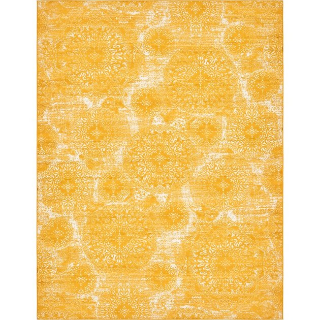 Yellow medallion pattern area rug from Wayfair