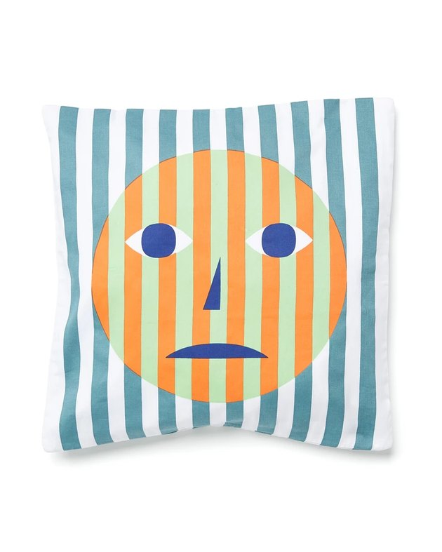 striped pillow cover with an unhappy face