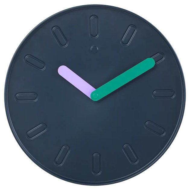 dark blue clock with colorful hands