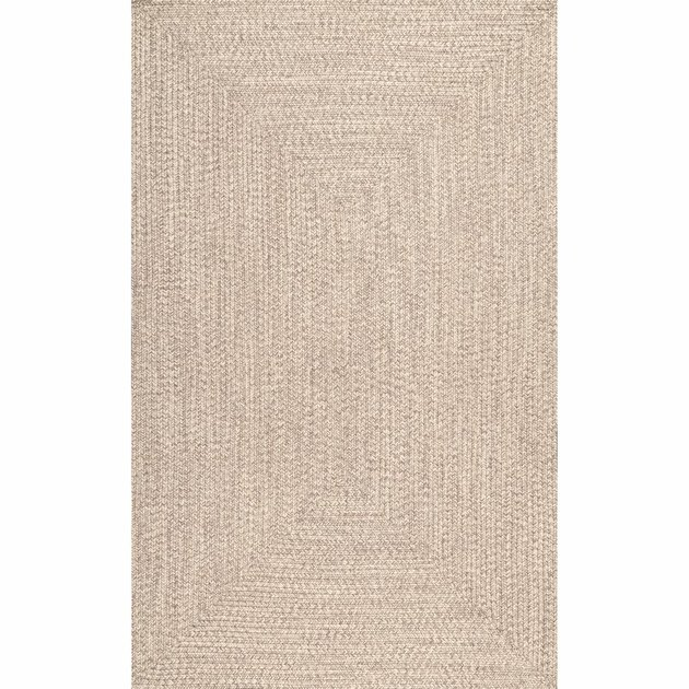 tan hand-braided area rug from Wayfair