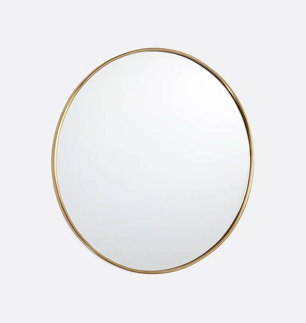 Round mirror with thin brass border
