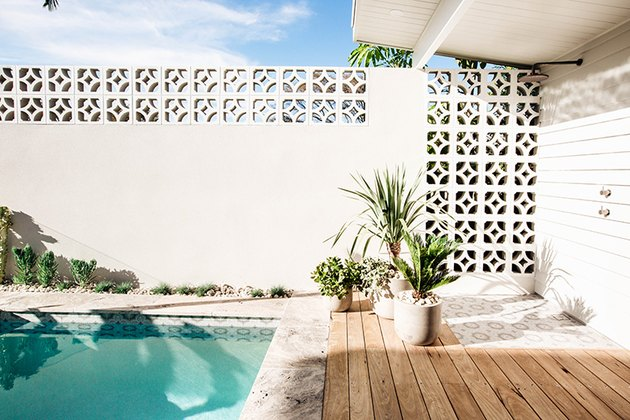 Rectangle-shaped backyard pool ideas with patterned cinder blocks