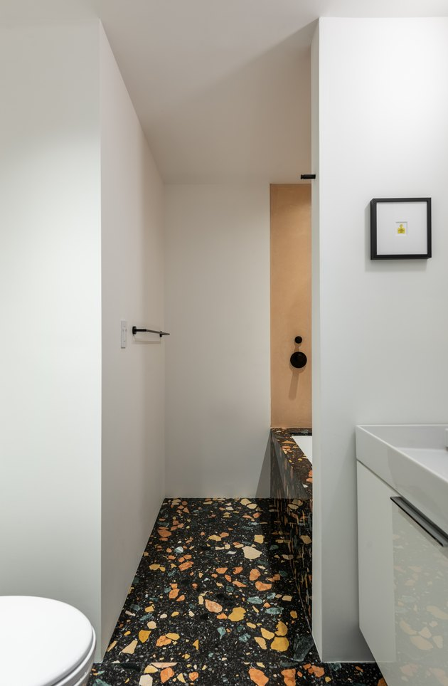 small bathroom with dzek floor