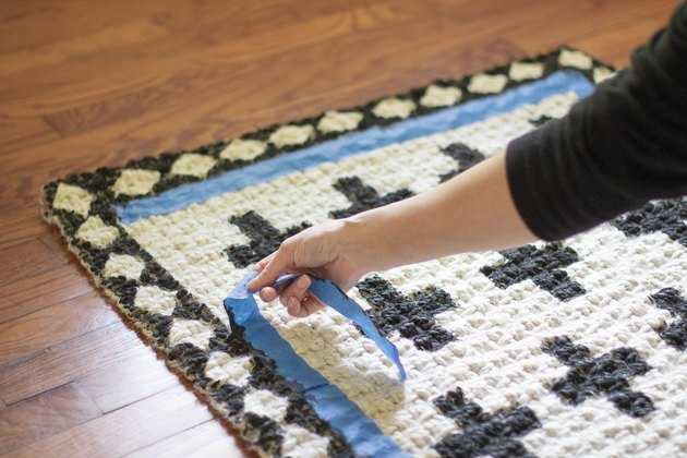 Pulling tape off rug